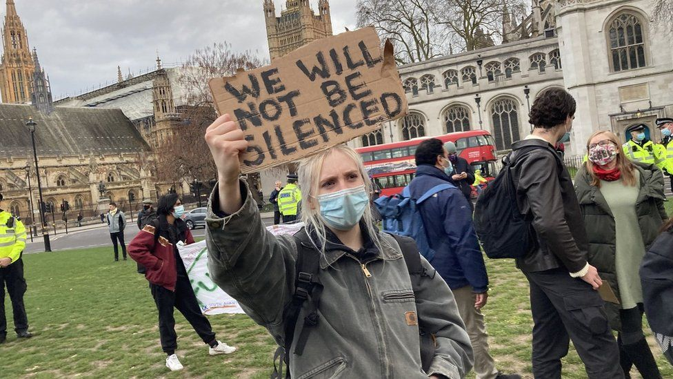 'It was clear that the deaths of George Floyd and Sarah Everard were weighing onthe Orwell Youth Prize 2021 entrants' minds.' A protestor gathers in Parliament Square to pay tribute to Sarah Everard.